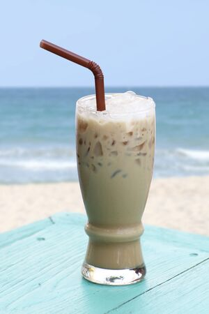 Iced coffee on  table beside the seaside. Stock Photo - 10520530