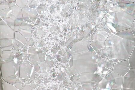 Bubbles in a glass of white background. Stock Photo