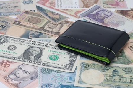 Currencies around the world with a purse. Stock Photo - 10793718