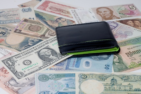Currencies around the world with a purse. Stock Photo - 11205252