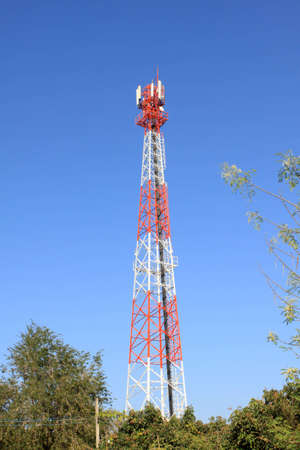 Telecommunication mast with blue sky background photo