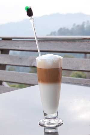 coffee blender: Coffee on the table. Background mountains.