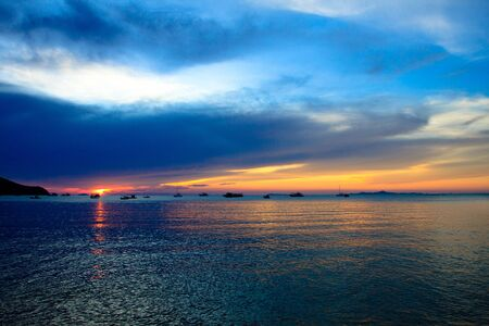 Fishing boat at sunset , Pattaya beach, east of Thailand Stock Photo - 13492366