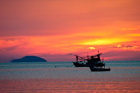 Fishing boat at sunset , Pattaya beach, east of Thailand