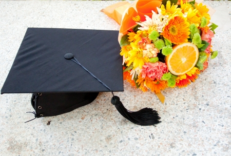 Graduation cap and  beautiful flower