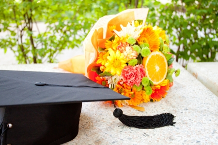 Graduation cap and  beautiful flower photo