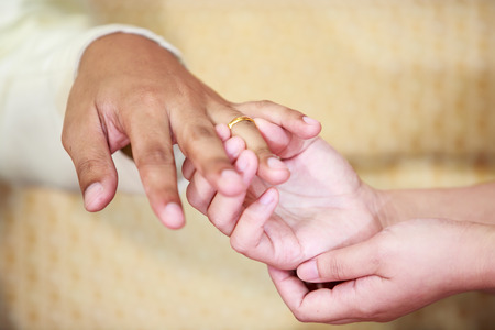 idealism: Hands and rings on wedding Stock Photo