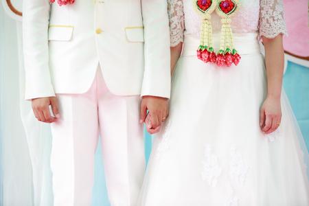 idealism: Lovers couple holding hands is enjoying wedding