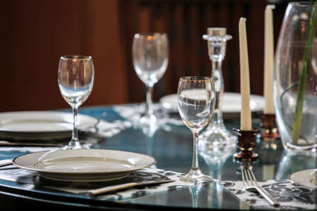 Empty glasses set in restaurant on the table Stock Photo