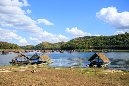 Bamboo rafting lake mountain in Thailand.
