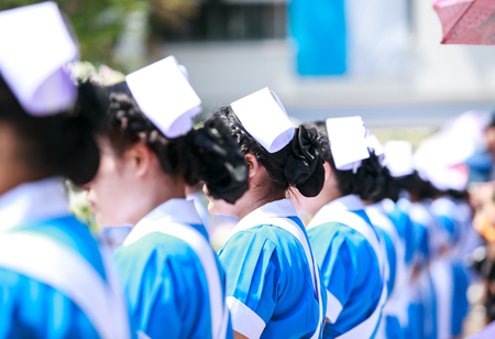 Crowd image of students nurse at graduation ceremony from behind