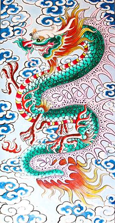 wood carving: The Colorful of old painting dragon on the wall of chinese temple in thailand