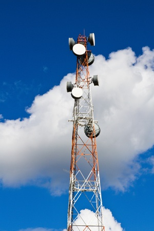 Telecommunication mast on blue sky