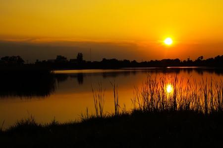 川で日の出 写真素材