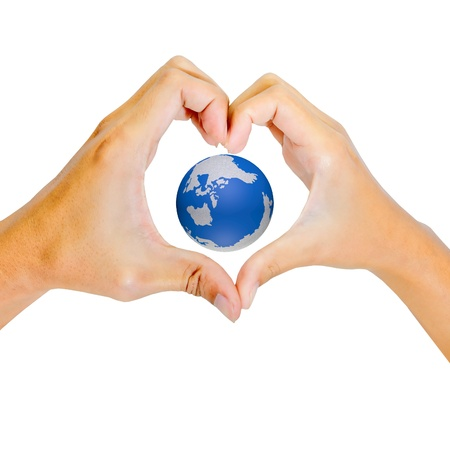 earth in Hands of a loving couple shaping a heart photo