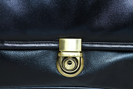 buckled: A black leather bag - the buckle - detail