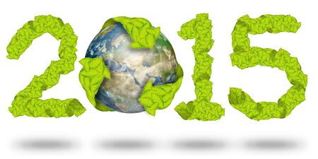 green leaves Recycle Logo on earth making a Pattern letter 2015 photo