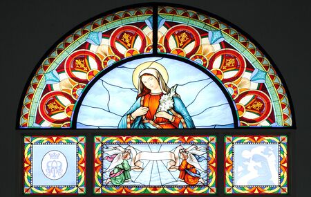 Stained glass depicting the Virgin Mary photo