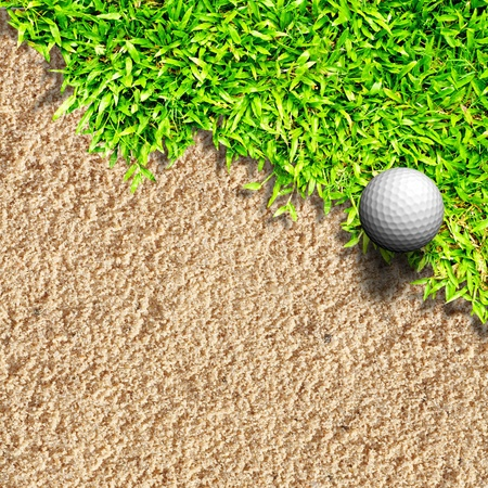 Golf ball on grass and sand photo