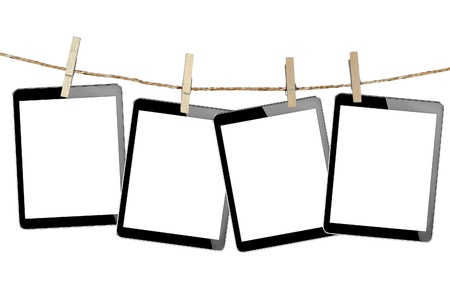 tablet computer pc in Wood clamps on white background  photo