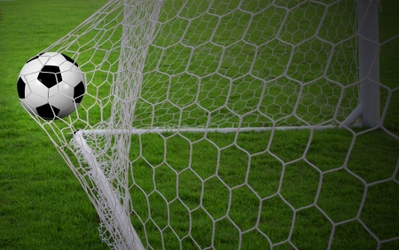 soccer net: Soccer ball in the goal Stock Photo