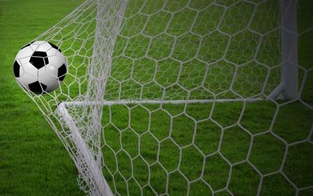 Voetbal bal in het doel Stockfoto - 15589067