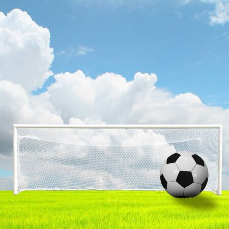 ballsport: soccer ball in soccer field on blue sky Stock Photo