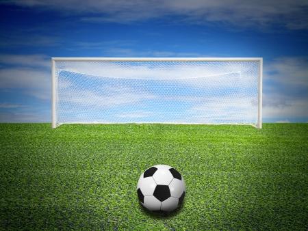 soccer ball in soccer field on blue sky Stock Photo