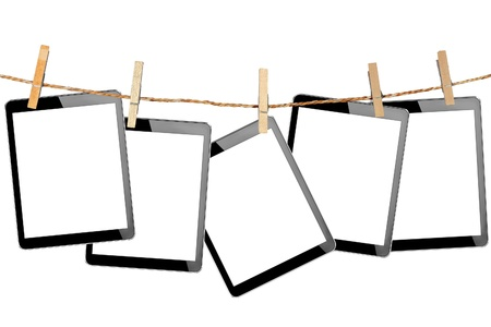 tablet computer pc with isolated screen in Wood clamps on white background  photo