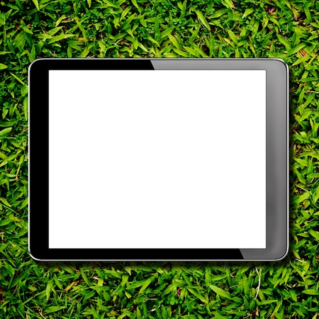 tablet computer pc with isolated screen on green grass photo