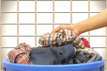 Hand picked clothes in a bucket of water. Stock Photo