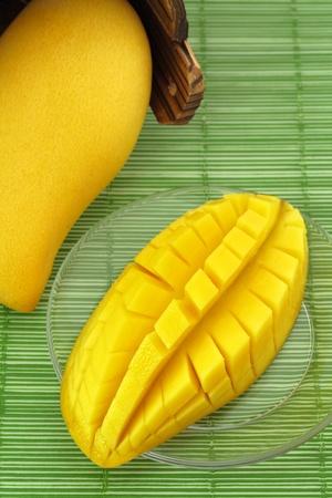 mango tree: Ripe mango on a plate and put the mango wood