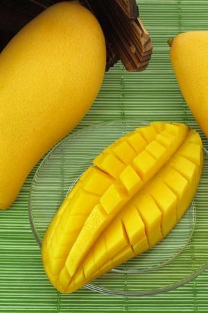 Ripe mango on a plate and put the mango wood  photo