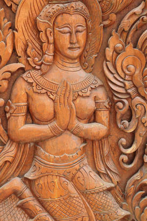 The angels are carved in the door of the temple of Wat Thai vow  photo