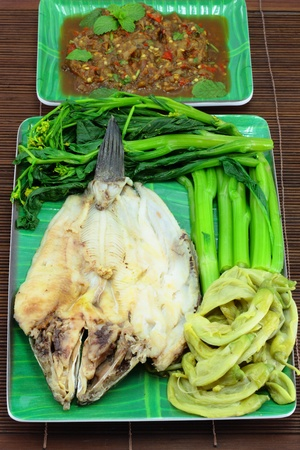 Thai cuisine name Steamed fish with boiled vegetables and sauce  photo