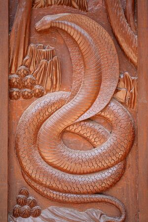 wood carving door: Animal carvings on the windows of the temple cult of Thailand