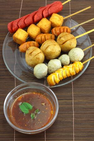 Many kinds of fried meatballs and sauce  photo