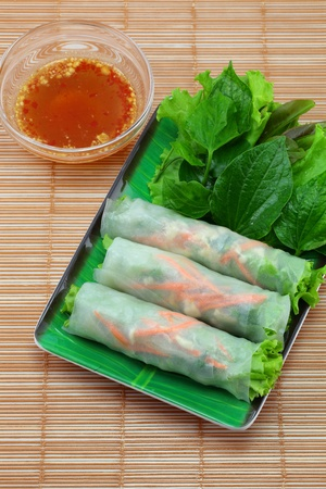 Vietnamese food Fresh Miang,Wrapped in a flour made   from vegetables and spices  photo
