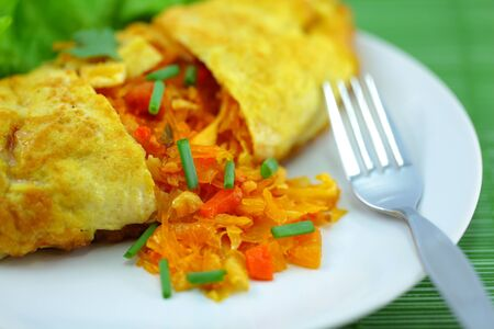 Omelet stuffed with spice  Stock Photo