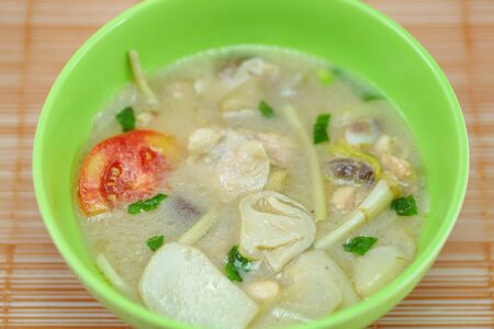 Thai food is a soup made   from galangal chicken  photo