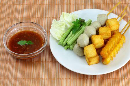 Many kinds of fried meatballs and sauce  photo