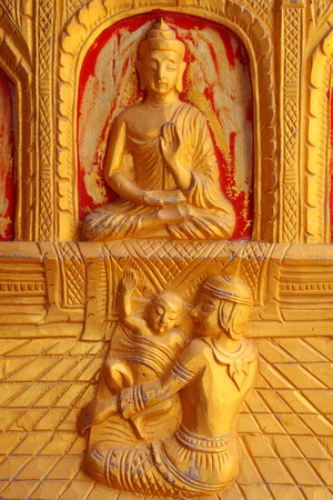 One of the carvings of many stories about the Buddha  Thai Buddhist Temple in the door Stock Photo - 13470035