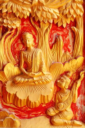 One of the carvings of many stories about the Buddha  Thai Buddhist Temple in the door  Stock Photo - 13470080