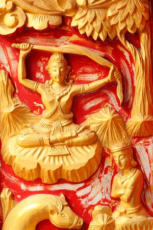 One of the carvings of many stories about the Buddha  Thai Buddhist Temple in the door  photo