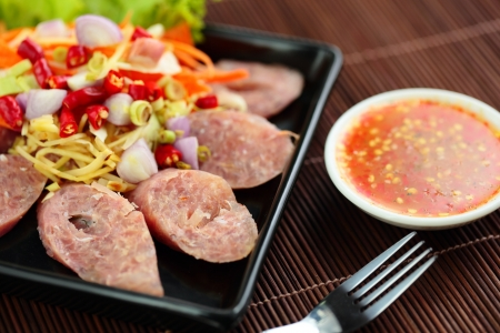 Thai food is made from pork and sauce  photo