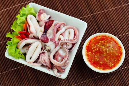 Boiled octopus and sauce  photo