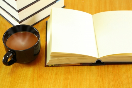 Book and a glass of black coffee  photo