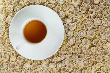 Cup of hot tea on a lemon grass background. photo