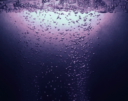 Air bubbles in water background. photo