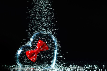 Box heart and bubbles in the water. photo